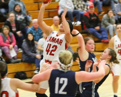 No. 42 Sierra White, sophomore, drives down the lane for a layup as the Lamar Lady Tigers pulled away for a double digit victory over Galena.