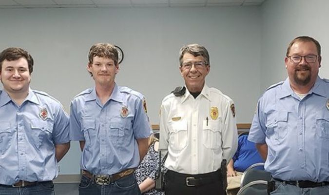 Four new volunteer fire fighters were added to the department during the May 20 city council meeting. Pictured with Mayor Kent Harris and Assistant Chief Rick Heinen are, left to right, Noah Shaw, Austin Morris, Trevin Brous, and Jason Colin.