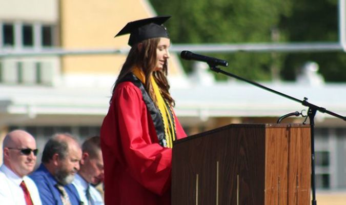 Photo courtesy of Zee Crossley Salutatorian Hallee Doss gives a speech over life's hurdles and Christian principles.