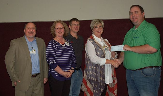 Lamar Democrat/Melody Metzger Members of the Lamar Rotary Club gathered following the veterans' appreciation luncheon held Tuesday, Nov. 12, at the Lamar United Methodist Church Family Life Center, to present a $500 check to Cindy McFadden. The money will be used to help with expenses incurred by Cindy and Lonnie McFadden, who will be taking a Life of Hope Ministries mission trip to Guatemala City. Life of Hope Ministries is a multi non-denominational ministry based out of Joplin and is dedicated to improving the lives of children who face poverty through education, emotional, physical and spiritual support. Pictured are, left to right, Dru Ashwell, Amy Neher, Chris Runion, Cindy McFadden and Rotary President Kevin Bull.
