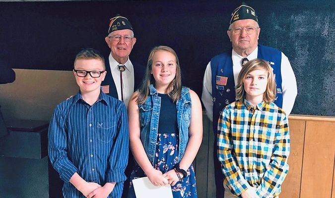 Patriot's Pen winners with a theme of What Makes America Great were, front row, left to right, Thomas Hull, first place; Layla White, second place and Carson Sturgell, third place. Pictured with them are VFW Senior Vice-Commander Merdith Chapman, left and member Tom Reed, right.