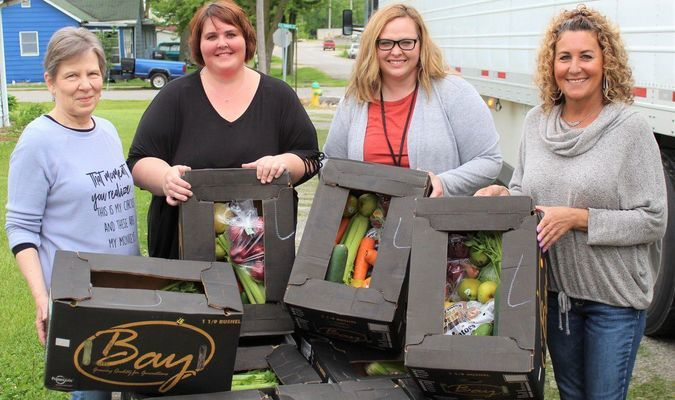 -R Monroe City Methodist Church Pastor, Olivia Earlywine; Food Pantry Administrator, Devlyn Timbrook; Shelby County Senior Citizens Center Administrator, Diana Hatcher; and Paris Senior Center Administrator, Tara Garside receiving their donated produce at Monroe City Food Pantry. Photo by Robin Gregg