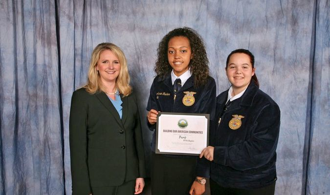 From left, Missouri Department of Agriculture Director Chris Chinn presents Aurea Rucker and Abigail Tuma of the Paris FFA Chapter with the Building Our American Communities Grant at the 89th Missouri FFA Convention in Columbia, Missouri, April 20-21, 2017. The Missouri Department of Agriculture sponsors the award.