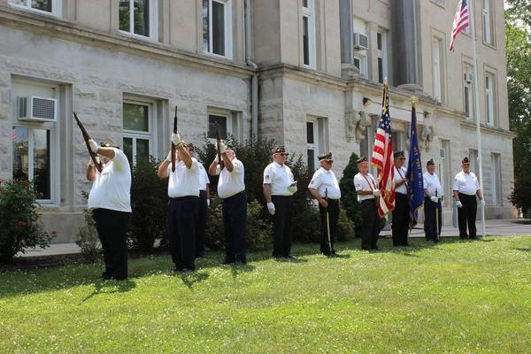 American Legion Honor Guard fires salute.