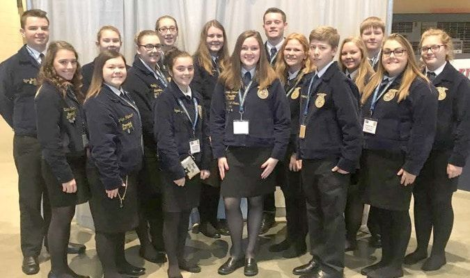 Madison FFA Chapter Members pose with their American Degree Recipient Hannah Deaver before the American Degree Ceremony. Front Row (L-R) Ashlyn Peterson, Abbie Thomas, American Degree Recipient Hannah Deaver, Joe O'Bannon. Middle Row (L-R) Katie Thomas, Emily Painter, Annika Salmons, Becca Ketchem, Miranda Breid, Danielle Herrin. Back Row (L-R) Tyler Buck, Rylee Thomas, Taylor Young, Jimmy Layton and Dalton Graham