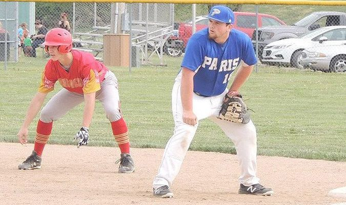 Coyote Zack Rentschler holds a runner on at first base.