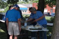 Volunteers setting up the Ice Cream and Cake table