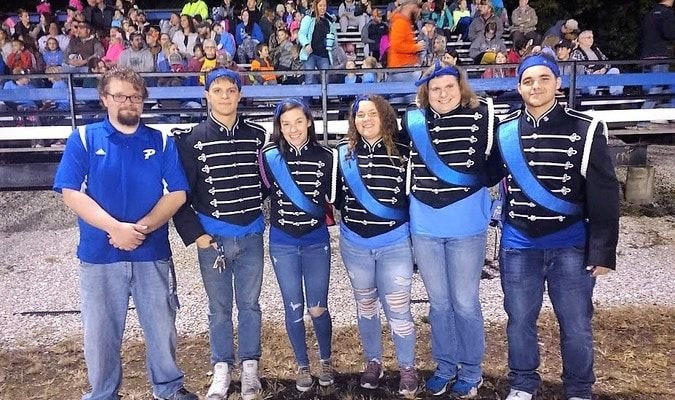 Director Jared Shulse poses with the Seniors of the Band on Senior Night - (from left) Charles Robertson, Delaney Miller, Mollie Cupp, Brianna Hamilton, and Dallas Howard