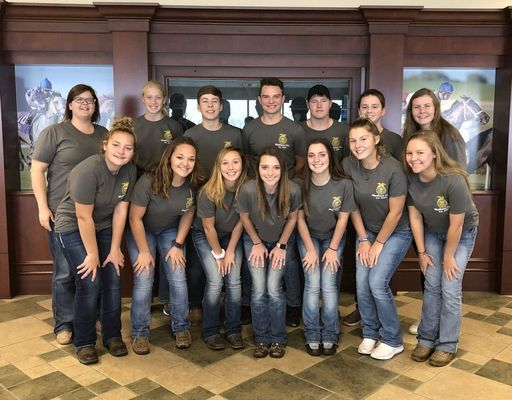 Madison FFA members and advisor got to experience the horse races at the Indianapolis Downs. (Front Row) Rebecca Youse, Peyton Hook, Lexi Wolfe, Katie Thomas, Abbie Thomas, Rylee Thomas, Miranda Breid. (Back Row) Miss Fields, Hunter Stockhorst, Joe O'Bannon, Tyler Buck, Dalton Graham, Reid Epperson, Annika Salmons