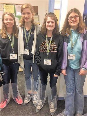 Kaylee Fulton, Alison Wilson, Sierra Beaver, and Anne Marie Quinn model their boot covers at Purdue's Dairy Farm
