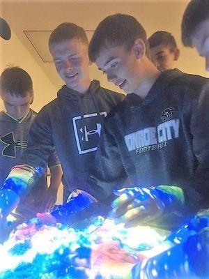 Matthew Barnes and Max Lehenbauer exploring the augmented sandbox at Parkland College.