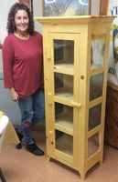 Harold Wilson donated this pie safe to Tara Garside, Paris Senior Center Director for the Christmas silent auction.
