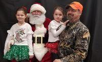 Kenlee, Kaybree, and Brandon Neer with Santa