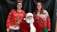 Laura Riley(Elementary Counselor), Santa, and Stephanie Weber(Elementary teacher)