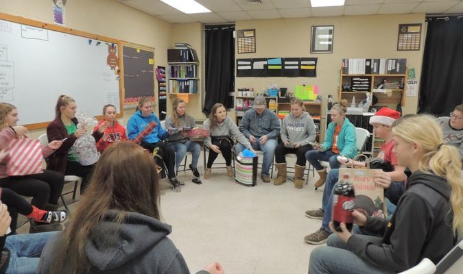 Madison FFA Members participating the Gift Exchange as Miss Fields reads a fun Christmas Gift Exchange Story.