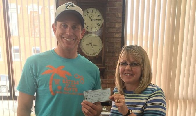 Left is Doug Buie presenting a check to Annette Bell, Monroe County Cancer Supporters Treasurer. Photo submitted by Doug Buie