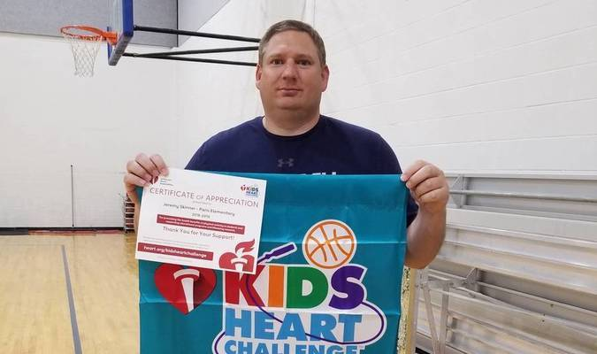 American Heart Association presented a School Recognition Banner and Certificate to Coach Skinner for leading Kids Heart Challenge this year at Paris Elementary