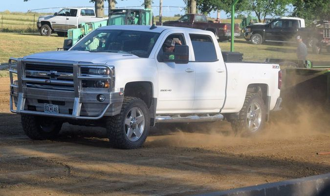 Contestant and announcer, Heath McCall of Holliday, pulls 301.8 ft. in his Chevy Duramax – Pullin 1
