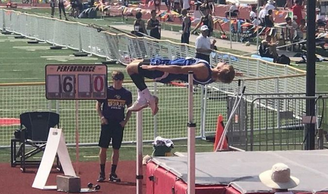 """Reese Barton clears his jump of 6'0"""" to move on to the next height. Photo courtesy of Paris R-II"""