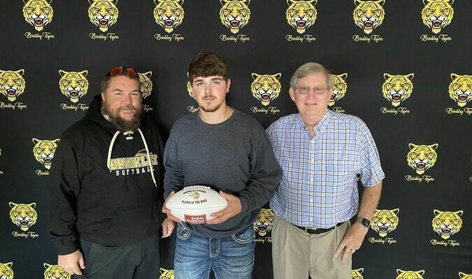 Brinkley Head Coach Ethan Baker, Ronnie Byrd, and Jimmy Reynolds, of Monroe County Farm Bureau
