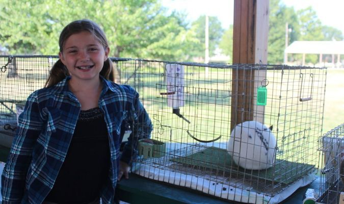 Zoe Eitel has been in the Bevier Buckaroos for two years and was showing her rabbit, Chocolate Chip, for the first time. She said rabbits are cute, fun, and she wanted another pet. Her favorite part of the fair is the whole thing.