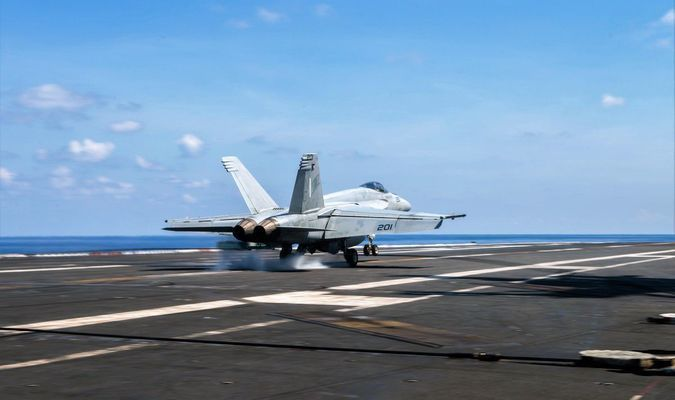 SOUTH CHINA SEA (May 19, 2016) - An F/A-18E Super Hornet assigned to the Tophatters of Strike Fighter Squadron (VFA) 14 piloted by Cmdr. Corey Pritchard lands on USS John C. Stennis' (CVN 74) flight deck at the conclusion of an aerial change of command ceremony. During the ceremony, Pritchard was relieved by Cmdr. Brian Emme. Providing a ready force supporting security and stability in the Indo-Asia-Pacific, John C. Stennis is operating as part of the Great Green Fleet on a regularly scheduled 7th Fleet deployment. (U.S. Navy photo by Mass Communication Specialist Seaman Tomas Compian/ Released)