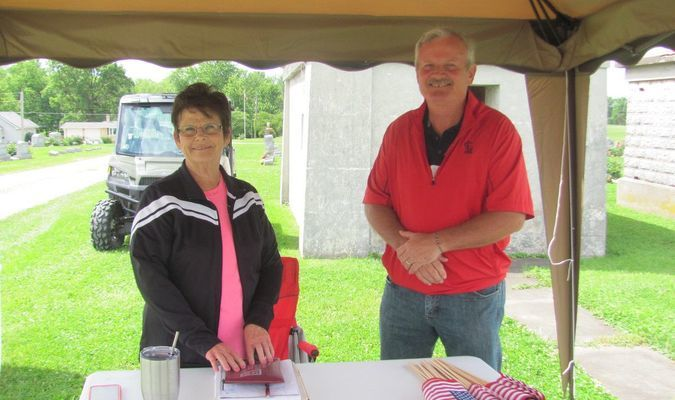 The La Plata Fire Department, City Employees along with the Cemetery Board Members, all were on hand manning a tent at the La Plata graveyard over the Memorial Day Weekend.  They aided people in locating lost loved ones, handed out Flags donated by the American Legion and took donations. Pictured is La Plata's illustrious Mayor, Lois Bragg and President of the Cemetery Board, Randy Travis.