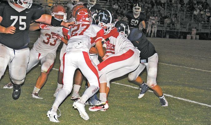 STACKED UP: Elgin defenders stop Marlow running back Jordan Smith on the 1-yard line in the Owls 27-14 win in Marlow last Friday night.