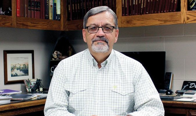 NEW BGOC PRESIDENT: Joe Ligon, pastor of First Baptist Church of Marlow, sits at his office at his church. Ligon was voted the new president of the Baptist General Convention of Oklahoma for a one-year term last week.