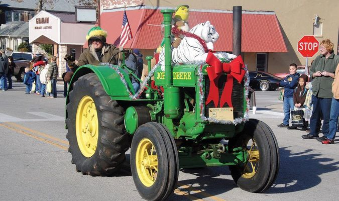 CHRISTMAS PARADE: A decorated antique tractor makes its down Main Street in Marlow during last year's Christmas parade. The 2016 version of the parade begins at 10 a.m. on Saturday.