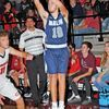 CATCHING FIRE: Marlow's Will Coffman shoots a three-pointer in the Outlaws' 64-40 win over Comanche last Friday night. Coffman knocked down six three-pointers in the second half to help the Outlaws pull away from the win.