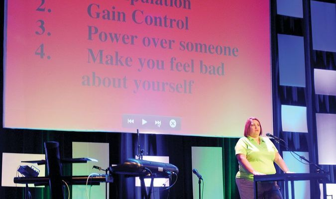 TEEN DATING VIOLENCE AWARENESS: Angela Wiles, mother of teenager Alyssa Wiles, who was murdered by an ex-boyfriend in June 2013, speaks to attendees of a teen dating violence awareness event at Connections Church in Duncan on Tuesday night.