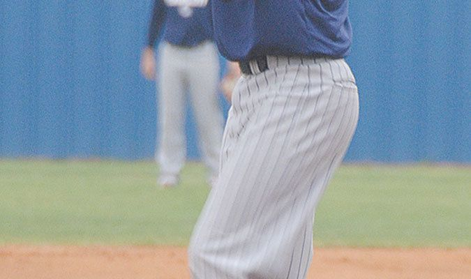 MACK ATTACKS: Marlow pitcher Ryan Mackey prepares to throw to the plate in the Outlaws' 11-2 win over the Indians. Mackey picked up the win on the mound for Marlow.