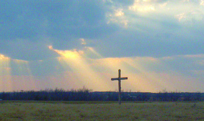 RESURRECTION SUNDAY: A cross stands alone in a field as sunbeams surround it. This Sunday marks the most holy day on the Christian calendar as believers celebrate the resurrection of Jesus Christ.