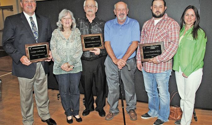 HONORED: 2016 Marlow Chamber of Commerce award winners on Monday night were: (from left) Citizen of the Year – George Coffman; Denise and Brian DiCintio of DiCintiio Pizza – Community Improvement Award; and Kenneth Glover, Justin Glover, and Melisha Glover of Glover Paint and Body Shop – Free Enterprise Award.