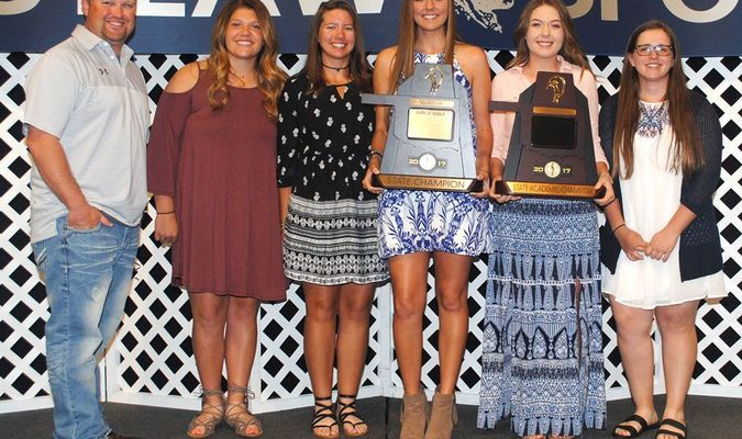 STATE CHAMPIONS: The Marlow girls golf team display their Class 3A State Champion and Academic State Champion trophies at the Marlow All-Sports Banquet. Pictured: (from left) coach Mikey Eaves, Mia Meshell, Alli Riddle, Kirstyn Elroy, Blair Brantley, and Britney Yates.