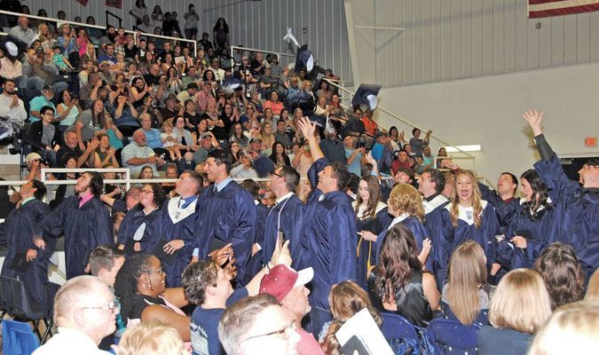 TIME TO CELEBRATE: The Marlow Class of 2017 toss their mortar boards in the air at the end of the graduation ceremony last Friday.