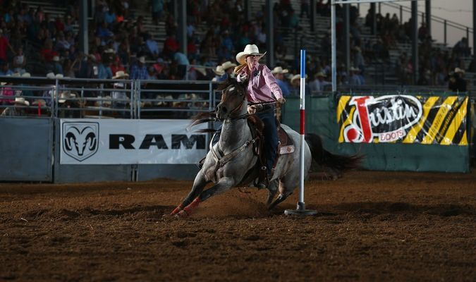 RACING THE CLOCK: Sydney Frey of Marlow competes in pole bending at the International Finals Youth Rodeo in Shawnee on Monday.