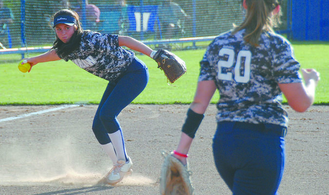 CONCENTRATION: Marlow third baseman prepares to make a throw to first base after fielding a ground ball in the Lady Outlaws 3-2 win at Central High on Tuesday.