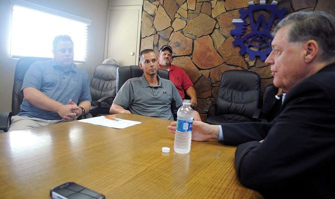 CONGRESSIONAL VISIT: U.S. Rep. Tom Cole of Oklahoma (right) speaks as Brad Boles (left), Jared Head, Scotty Williams of Wilco Machine & Fabrication leadership at the business last Wednesday afternoon. Also pictured is Cole's local representative Thomas Lewis.
