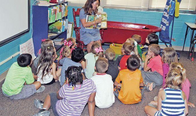 VOLUNTEERING: Jackie Lewis of Duncan reads to first graders at Horace Mann Elementary School in Duncan as part of United Way of Stephens County Readers & Leaders program that re-started last year.