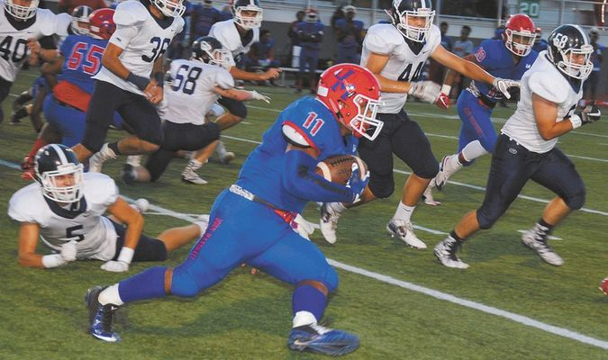 PURSUIT: The Marlow defense tries to track down John Marshall star running back Devonte Lee during the Outlaws and Bears district game in Oklahoma City last Friday. Lee rushed for 216 yards in the 40-13 John Marshall win.