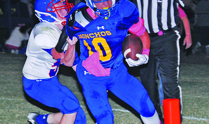 TWO POINTS: Central High quarterback Bryson Johnson crosses the goal line for a two-point conversion before Bray-Doyle defender Mark Kilbourn can stop him in Central High last Friday night.