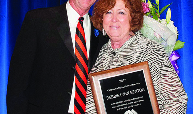 REALTOR OF THE YEAR: Debbie Lynn Benton, 2017 Oklahoma Association of Realtors Realtor of the Year, poses with 2016 winner Mike Craddock, who introduced her, last week.