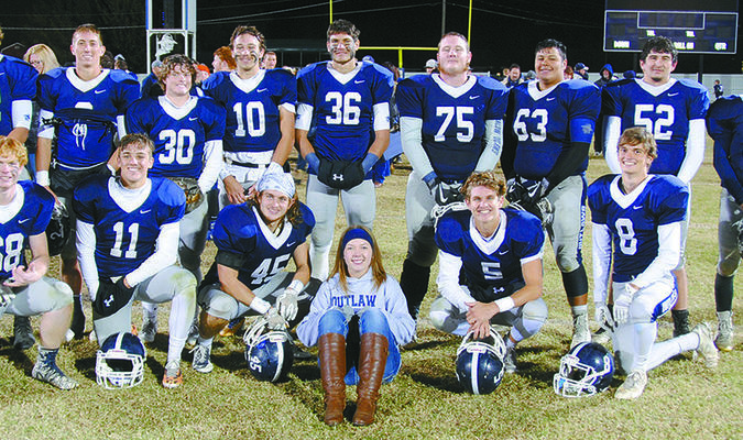 HOME FINALE: Marlow seniors celebrate a 70-15 win over Comanche in their final regular season home game last Friday night. The seniors never lost a game to the Indians in their high school careers.