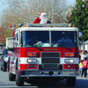 SANTA SLEIGHS IT: Santa Claus rides down Main Street as the Marlow Christmas Parade wrapped up on Saturday morning.