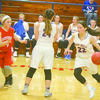 GETTNG BY: Bray-Doyle's J'Cee Edwards takes advantage of Kaily Early's screen in a win over Maysville last week.