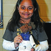 HAVE PASSPORT, WILL TRAVEL: Lenny the moose had his picture taken with Aiesha Patel, with whom he traveled to India for three weeks. Her family made him the traditional Indian clothes to wear.
