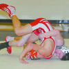 OVER THE TOP: Marlow's Kyle Davis attempts to pin his Sulphur opponent in their match last Thursday. Davis won the match, 7-4.