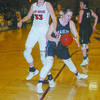 FIGHTING FOR A REBOUND: Marlow's Brooke Morriston fights off Comanche's Misty Dossey in the championship game of the Stephens County Tournament on Saturday. Comanche won the game, 52-26.
